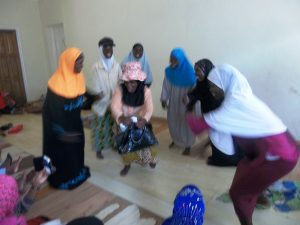 Women from Mtendere perform a drama