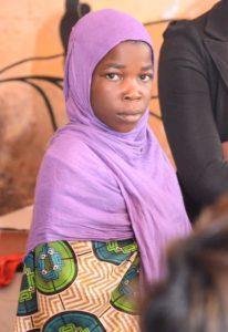 Muslim girl from MASYAP in purple headscarf