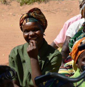 Woman answering question as part of HIV quiz, Balaka, Malawi