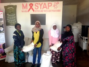 The HTC and Youth Coordinator and Office Assistant distribute ufa to MASYAP members